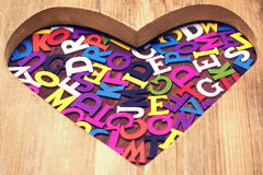 Many Colored Letters In The Wooden Heart Shape Stock Photos