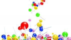 Many colored lollipop fall on white background stock footage