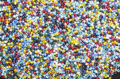 Many-colored mix of beads Stock Photo