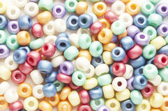 Many-colored mix of beads Stock Photos