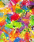 Many Colored Paper Clips on White. Stock Images