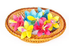 Many colored paper flowers in a basket Royalty Free Stock Images