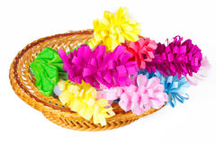 Many colored paper flowers in a basket Royalty Free Stock Image