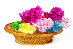 Many colored paper flowers in a basket Royalty Free Stock Photography