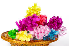Many colored paper flowers in a basket Royalty Free Stock Photo