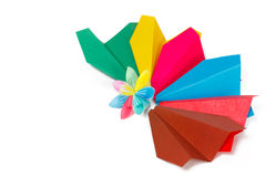 Many colored paper panes and flower. With varicolored petals Royalty Free Stock Image