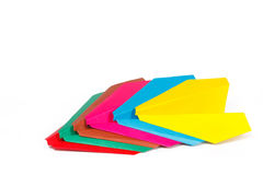 Many colored paper planes. On a white background Stock Photos