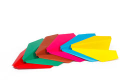 Many colored paper planes. On a white background Royalty Free Stock Photos