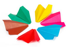 Many colored paper planes. On a white background Royalty Free Stock Image