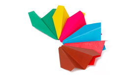 Many colored paper planes. On a white background Royalty Free Stock Images