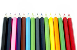 Many colored pencils aligned on white background Stock Photos