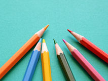 Many colored pencils on blue background Stock Images