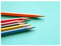 Many colored pencils on blue background Stock Photos