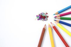 Many colored pencils in circle in a white background. Composition Stock Images