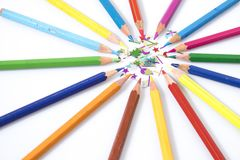 Many colored pencils in circle in a white background. Composition Royalty Free Stock Image