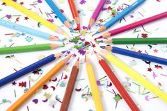 Many colored pencils in circle in a white background. Composition Stock Photos