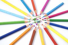Many colored pencils in circle in a white background. Composition Stock Image