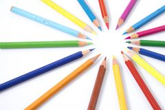 Many colored pencils in circle in a white background. Composition Stock Photography