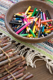 Many colored pencils lying in a plate Stock Image