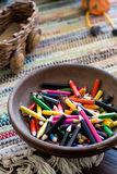 Many colored pencils lying in a plate Stock Photography
