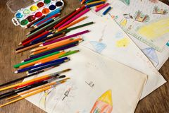 Many colored pencils and paint brush royalty free stock photography