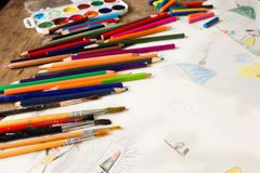 Many colored pencils and paint brush Stock Images