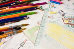 Many colored pencils and paint brush royalty free stock image