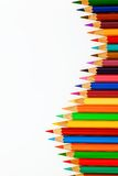 Many colored pencils on white background stock images