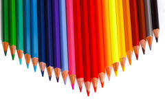 Many colored pencils. On a white background Royalty Free Stock Photography