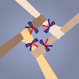 Many colored people's hands with USA's flag color ribbons. On blue background Royalty Free Stock Image
