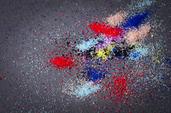 Many colored powder paint makeup artistry abstract scattered on. A black background stock images