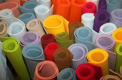 Rolls of fabric. Many colored rolls of fabric in the store Royalty Free Stock Image
