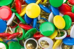 Many colored tacks Stock Photo