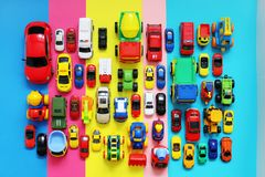 Many colored toy cars on multicolored background. Top view royalty free stock images