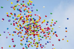 Colorful baloons in the sky. Many colorful balloons flying in the air Royalty Free Stock Images