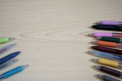 Ballpoint Pens on wooden table. Many colorful Ballpoint Pens on wooden table background with space area royalty free stock photos