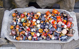 Many colorful beautiful ceramics jugs in market Stock Photography