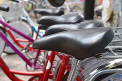Many colorful Bicycles stanging in a row. Urban retro bicycle, service and Bicycle rental Royalty Free Stock Photo