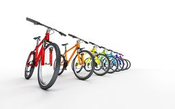 Many colorful bikes standing in a row isolated on white backgrou. Nd. Advertising concept Stock Photo