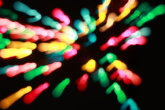 Many colorful blurred bokeh patterns on black. Background stock photo