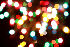 Many colorful blurred bokeh patterns on black. Background royalty free stock image