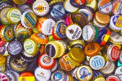 Many colorful bottle caps, mostly from beer bottles royalty free stock photo
