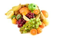 Many colorful, bright, fresh fruit on a white background. Kiwi, grapefruits, bananas, grapes, lemon, mandarins, oranges Royalty Free Stock Image