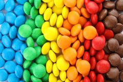 Many colorful candies as background. Top view stock photo