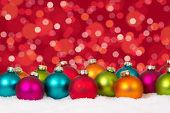Many colorful Christmas balls background decoration lights snow Stock Photos