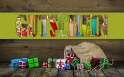 Many colorful christmas presents on wooden old background. Royalty Free Stock Photo