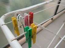 Clothes pegs on a white line dryer royalty free stock photography