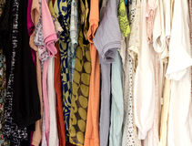 Many colorful clothes in wardrobe Royalty Free Stock Photos