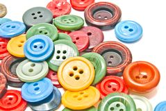 Many colorful clothing buttons. On white background Stock Photos