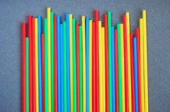 Many colorful cocktail tubes. On grey background Stock Image